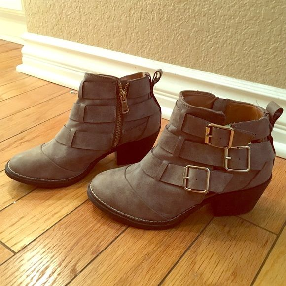 Brown booties Brown bootie little heel with zipper on the side and gold buckles on the other! Super cute never worn! Size 6 Shoes Ankle Boots & Booties