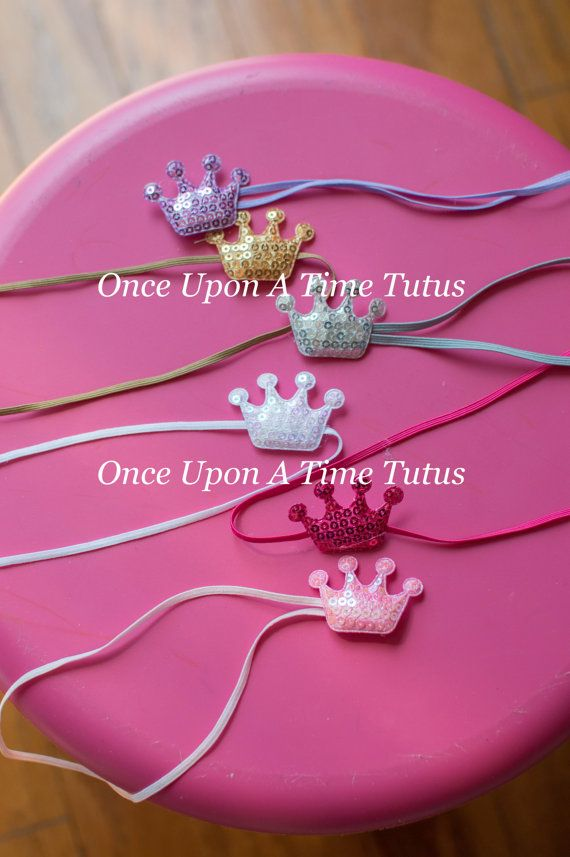 A 1.5 mini sequin crown on a matching skinny elastic headband is perfect for even the tiniest princess. Now you can choose from other colors too! Please choose color from the drop down menu when ordering.  -Lavender  -Gold  -Silver  -White  -Hot Pink  -Light Pink      ** Cute party favor idea **    ** Perfect newborn, infant, or toddler photo prop **    Check out my shop for other great headbands and accessories! Great for photo props, gifts, special occasions, etc. Headband sizing…