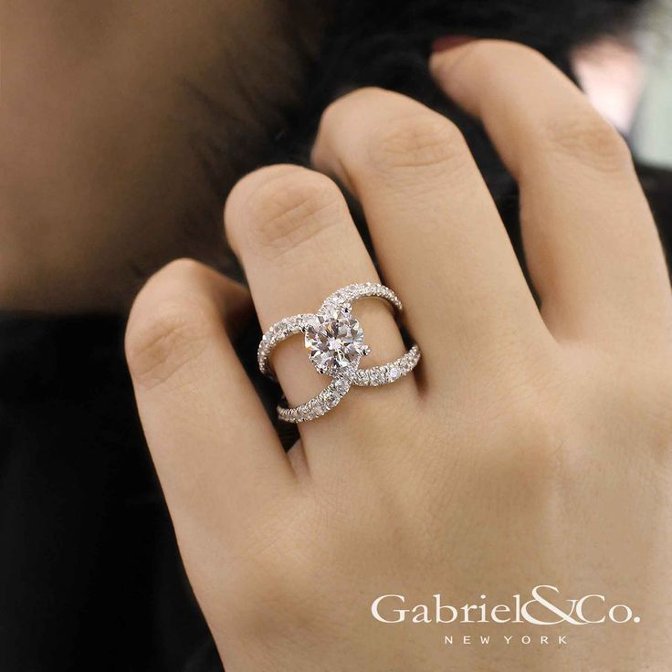 Gabriel & Co. - Voted #1 Most Preferred Bridal Brand.   A brightly, unique split shank band complements the classic round diamond engagement ring.