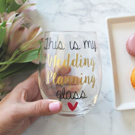 Sip some champagne or wine out of this adorable glass while planning your perfect wedding. This listing is for ONE wine glass. You may customize vinyl colors, free of charge and even add your own personalization on the back.  THE SPECIFICS: - 15oz stemless wine glass - Product Dimension: 4.5 x 3 inches - Hand wash only  Options: Non-Personalized: Front design only Personalized: Add a name, date or small saying to the back (see photo #2)  HOW TO PURCHASE: Please leave vinyl and…