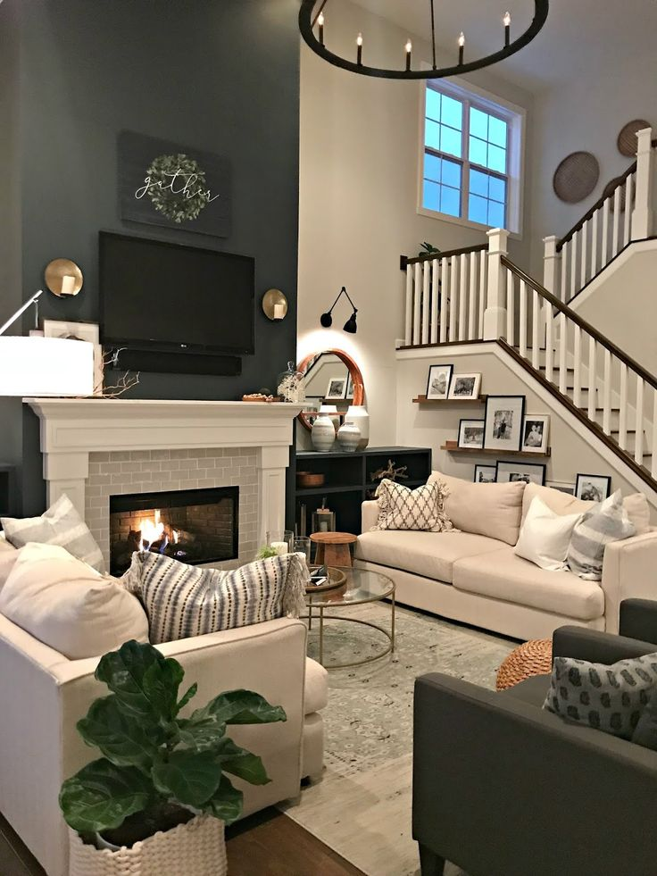 Tall fireplace and open stairs in family room Family