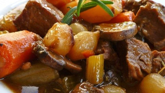 Beef, carrots, potatoes, and celery are seasoned with rosemary and parsley in this simple stovetop beef stew recipe.