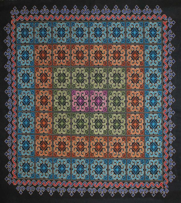 Hmong Embroidery  Cross stitched on monk's cloth with elephant foot and ram's horn motifs.