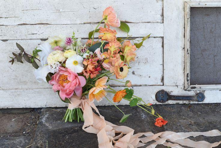 october flowers, bridal bouquet, spring flowers, coral peony, poppies, ranunculus, nasturtium, bearded iris, sherbet tones, orange, creamy yellow, white, ivory, spring wedding, silk ribbon