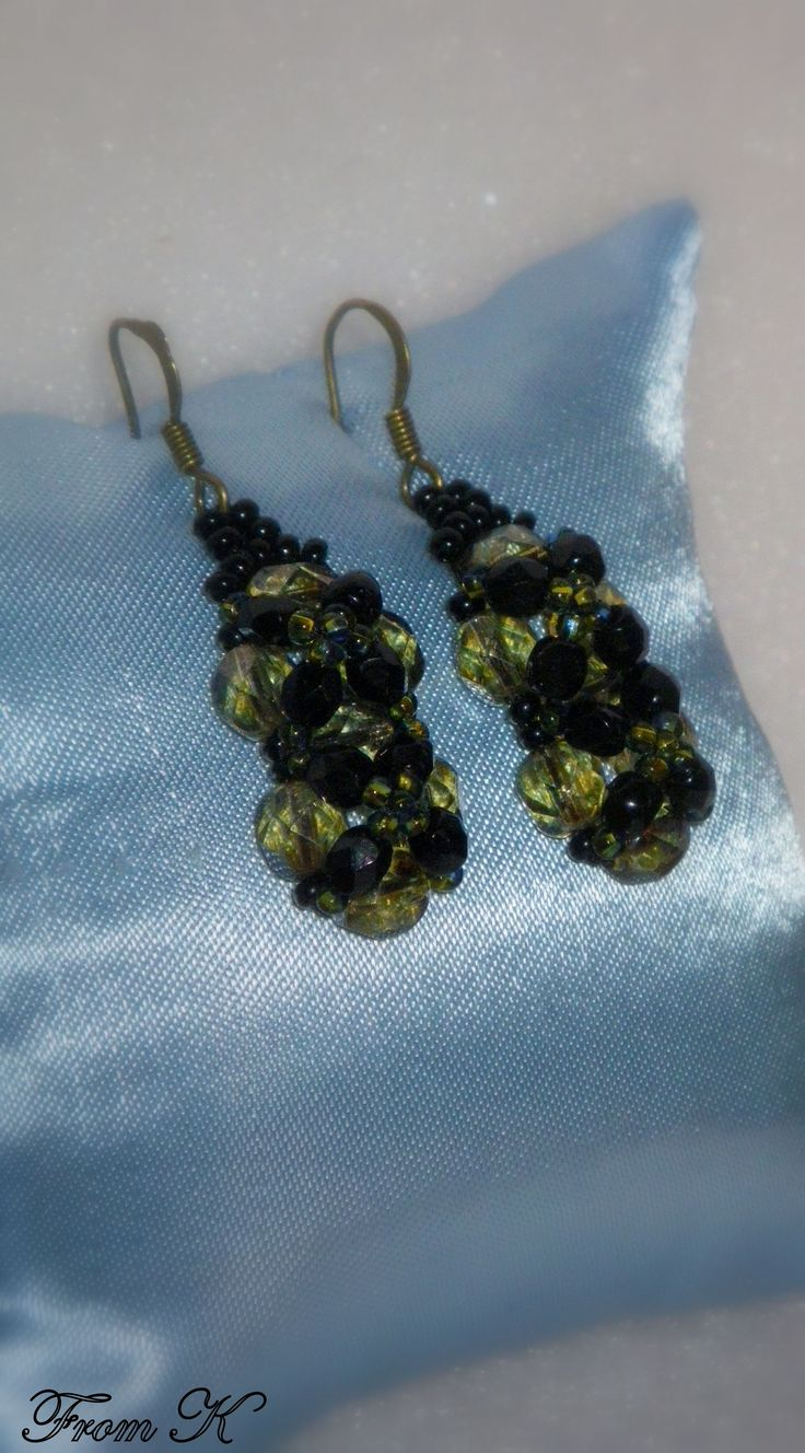 #Crystal #Dangle #Earrings. Dress up any outfit with these dramatic and elegant hand beaded glass crystals and seed beads earrings. Quite unique combination of colors -- pure black and translucent olive green. About 3,5 cm long with the ear piece 15.00 Ron  For more photos, prices and other info, please visit my facebook page https://www.facebook.com/BeadsFromK/photos/
