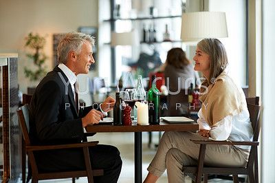 Portrait of joyful senior couple dining at the restaurant - stock photo #54510