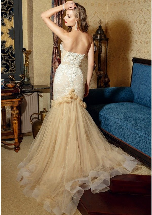 Nude wedding dress made of ivory applications of tulle and lace Mermaid silhouette with heart neckline and cups included Lace, beads and pearls applied manually Strapless Corset Closes at the back with hidden zipper Long train