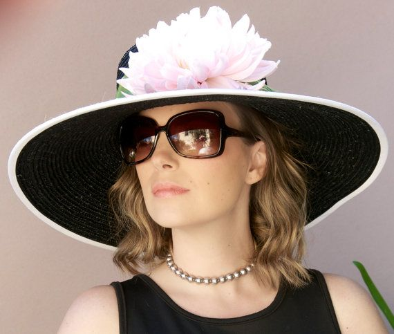 AWARD MILLINERY DESIGN    This black, wide brim straw hat is a very tight weave and will completely protect the face from the sun. This is a