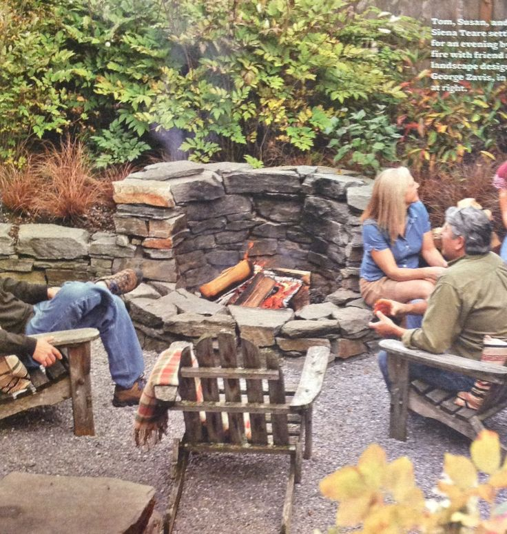 Stone Fire pit Wall ~ Oct '13 Better Homes. Love the natural stone.