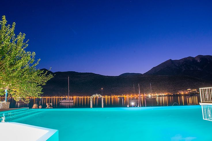 Seaside Restaurant Geni Lefkas Lefkada Greece. Moonlit skies of August over Vlyho Bay by VAG