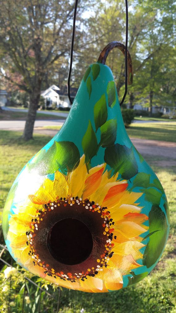 Hand painted gourd birdhouse in turquoise sunflower design with leopard print stem and leather hanger. I can add initials or name to back of