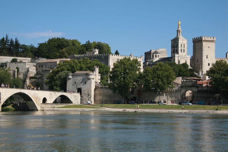 Palais des Papes | Avignon | Built in the 14th century | to transform Avignon into the capital of the Christian world | the Palace of the Popes |The Pont d'Avignon has been immortalised in song |  the cheerful children's song | dancing on the bridge dates back to the 15th century |