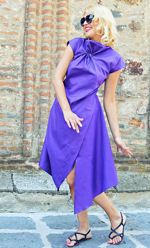 Purple cotton dress with a twisted asymmetrical cut. Playful and fun to wear, this bright dress is made of pure cotton, being soft and comfortable, a must-have for this season! Material: 95% cotton, 5% elastane  Care instructions: Wash at 30 degrees  The model in the picture is size S.  Can be made in ALL SIZES.  If you have any other specific requirements, do not hesitate to contact me!  I DO NOT CHARGE EXTRA MONEY for custom made items.   All you need to do is send me your measurements…