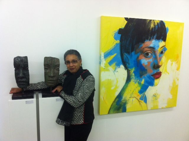 """Lionel Smit face """"Fragments"""" sculptures. The painting is also by Lionel Smit"""