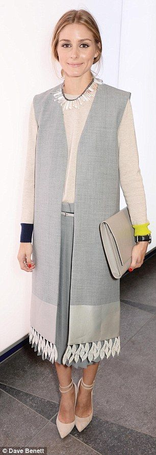 Olivia Palermo at London Fashion Week's Whistles SS15 / A chunky necklace often adds contrast of colors, but sometimes, like in this outfit, a contrast in texture adds that unique touch without taking the attention away from the clothes.