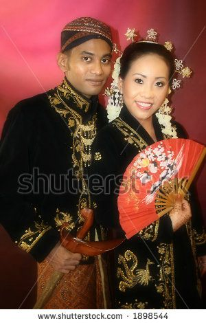 a-malay-bride-and-groom-in-their-traditional-javanese-costume-on-the-day-of-their-wedding