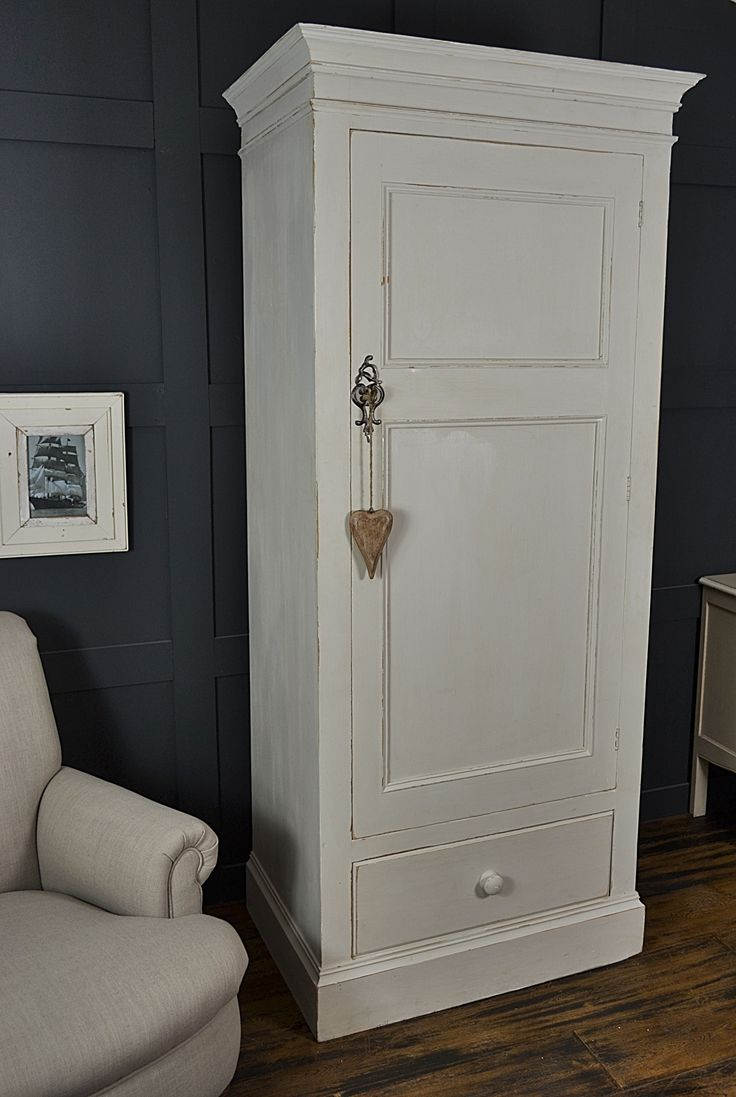 Short on space? This slimline single door wardrobe with drawer has plenty of storage with hanging space of 730mm. Painted in Farrow & Ball Shaded White and lightly distressed and waxed.