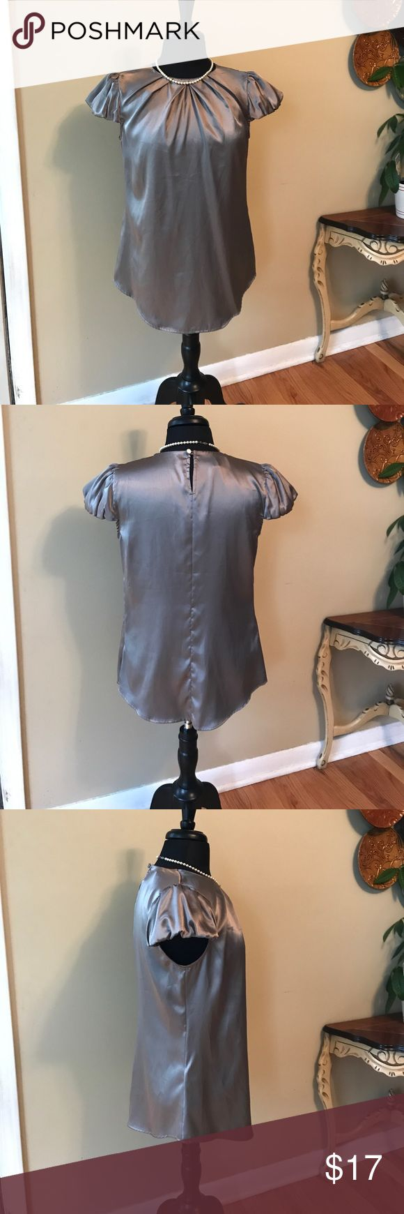 Mango Suit Coco Brown Blouse Size 10 Mango Suit Coco Brown Blouse. Size 10. Marked XL because it is a European Label.  Rey faint pull marks caught through my lens. (See picture) hard to see in person. Hidden side zipper. 🚫trade. Please ask all questions prior to buying mango suit Tops Blouses