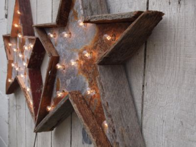 Wonderful rustic wood with rusted metal backs to hold fairy lights ...