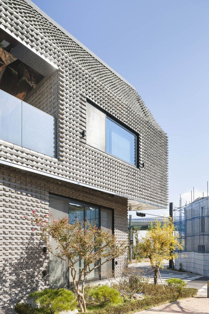 Angled Bricks Make The Exterior Of This House Textured And Prickly