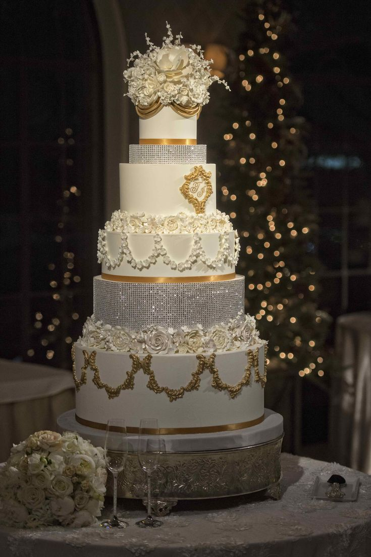 Classic Christmas Wedding Inspiration   Gorgeous wedding cake featuring rhinestones and French-inspired detailing. The gold accents work so beautifully with the Christmas tree in the background!   Wedding Planner: DFW Events, dfwevents.com   photo: Edmonson Weddings