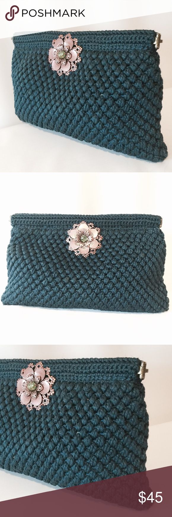 "Handmade Teal Crochet Clutch With Copper Flower One of a kind treasure! This amazing clutch is handmade, fully lined, has metallic copper flowers on both sides with beaded center. Featuring magnetic snap closure.   7"" H X 11"" W   100% poly  Spot clean only Bags Clutches & Wristlets"