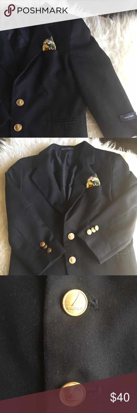 Nautica Kids Navy Blazer Single-breasted, two button blazer featuring a flat chest pocket, 2 flat hand pockets and a 3 button cuff. Gold- tone buttons lend a prep edge to this classic piece. Fully lined, Dry clean only Nautica Jackets & Coats Blazers