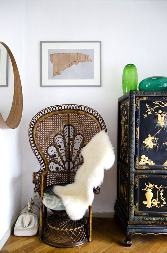 Nathalie & Michiel's arty eclectic apartment // peacock chair & chinese credenza