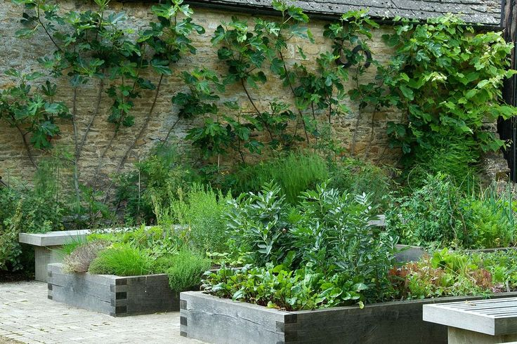 Gloucestershire — Dan Pearson. check out the stone walls, wood planters and the brick walk.  And there aren't even flowers, rather veggies and it's amazing.