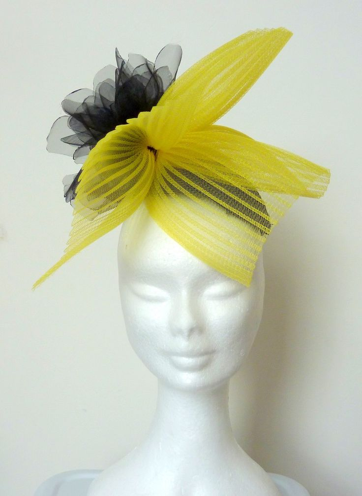 Race hat yellow black/cocktail hat yellow Yellow crin, black silk kidney-shaped base and black organza flower. Handmade, hand blocked.