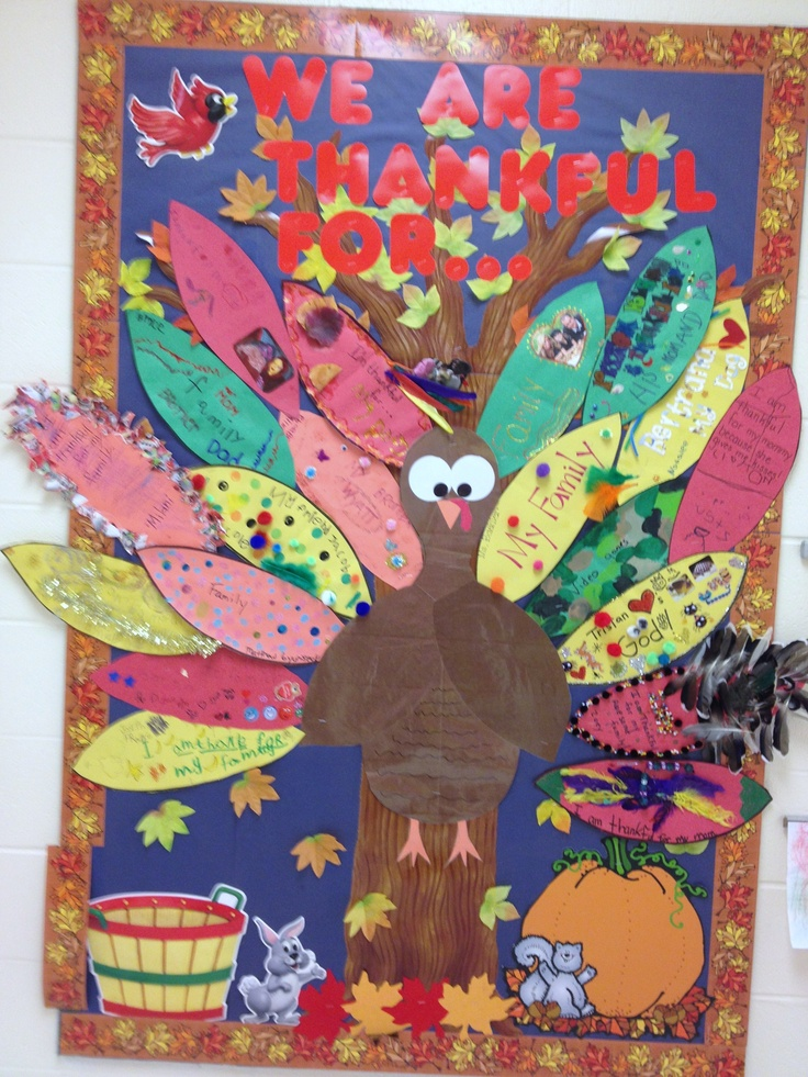 Thanksgiving bulletin board kids take feather templates for Ways to decorate a bulletin board
