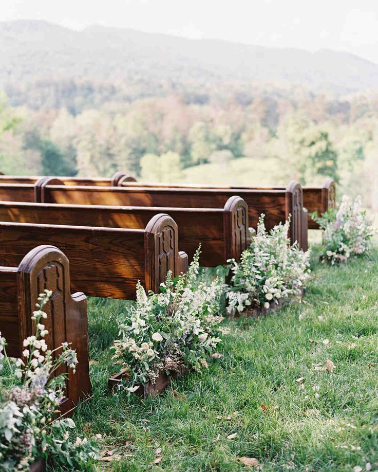 """A Fun-Filled Farm Wedding in Tennessee   Martha Stewart Weddings - For the outdoor ceremony, floral designer Amy Osaba lined the church pews with 15 foot-long flower boxes overflowing with delphinium, lisianthus, foxglove in white and green and varying shades of lilac, violet, and lavender. """"We didn't want the florals to compete with the beautiful view, so Amy and her team used foraged greenery from the farm."""""""