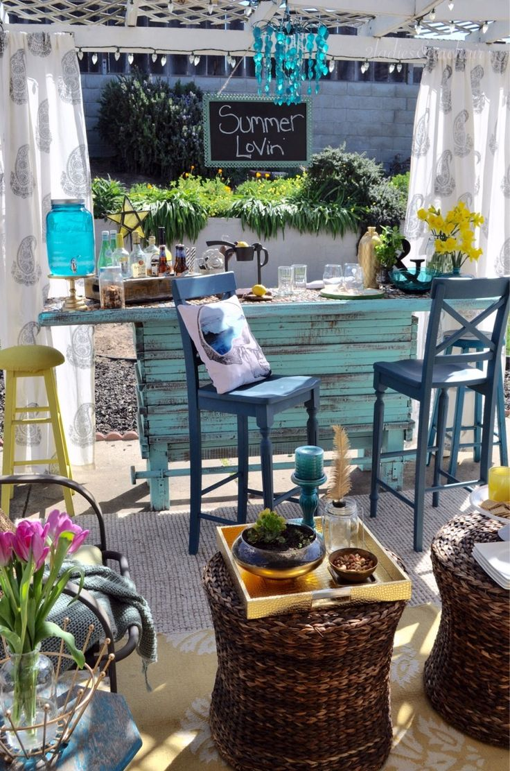 Little Turquoise Bar Set At Edge Of Patio.