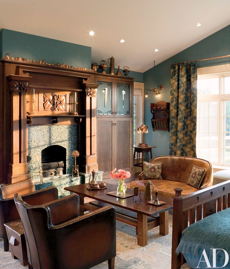 """The house """"is furnished in the ultimate eclectic style,"""" says Adler, who filled the master bedroom with Arts and Crafts pieces she collected with her late husband, Herbert. The 1890s candlestick on the Arts and Crafts mantel is by W. A. S. Benson. Duralee drapery fabric. Stark carpet."""