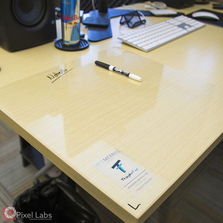A clear adhesive whiteboard for desk! Get a 1' x 1' ThoughtTop for only $14.99. Comes bundled with a special marker that won't erase with your hands, but comes off with water! www.ThoughtTop.com