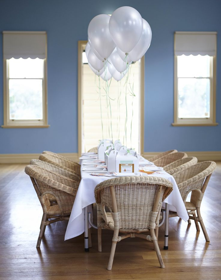 LETTUCE & CO - STYLE. EAT. PLAY run, run, as fast as you can gingerbread man themed children's birthday party. mint green, sky blue and orange colour scheme. concept design and styling by us. kids party table and chairs. gift goody party boxes with balloons. table styling.