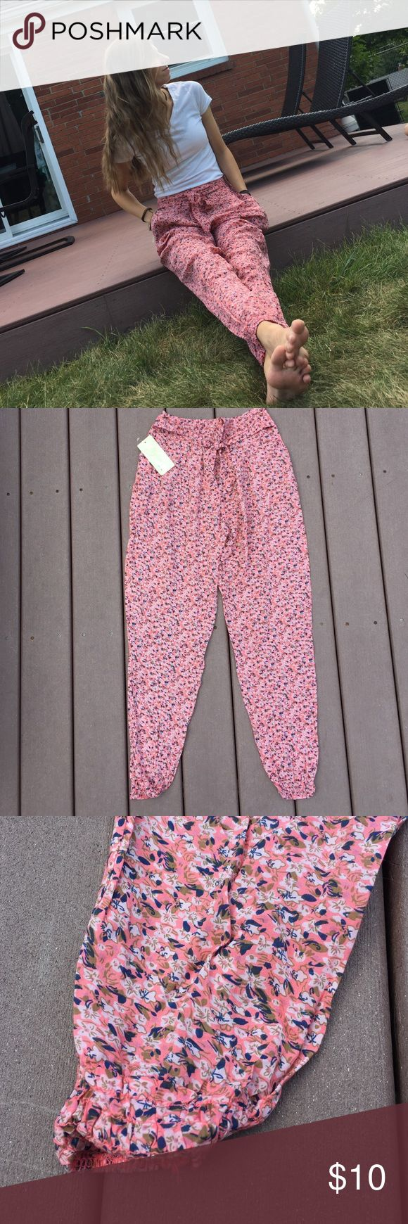 High Wasted Floral Print Parachute Pants. High wasted. Floral print. Purchased in Rome, Italy! With tags on. Elastic Ankles. Model 5ft. 8 in. Pants Track Pants & Joggers