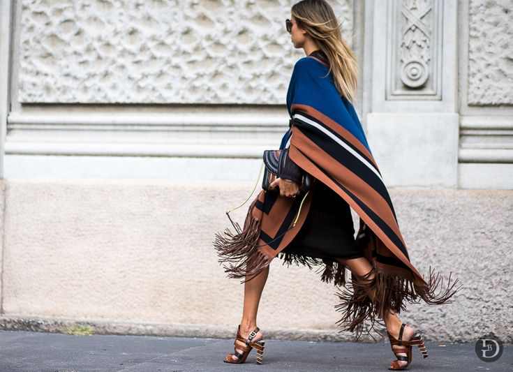 Colourful stripes belong to one of the most important trends this season  and this look by Italian stylist Erica Pelosini Leeman demonstrates it  perfectly without making it too crazy. Key? Having a dark base and stick to  a maximum of three colours + a splash of a bolder colour. Did you try this  yet?