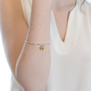 A single rose thorn hangs from this solid silver bangle.  BANGLE WITH THORN - silver & 18ct yellow gold vermeil £130.