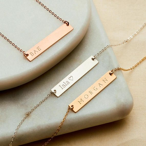 A wide personalised bar necklace in either 14k Gold fill, Rose Gold fill or Sterling Silver.  These beautiful bar necklaces can be personalised with a name, date, Roman numerals, a word or symbol of your choice, or you could even leave it blank!  Available in 14k Gold Fill, 14K Rose