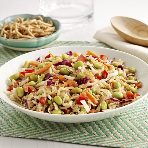 A no-cook side dish recipe combines coleslaw mix, bean sprouts, edamame and red bell pepper with a simple soy sauce vinaigrette