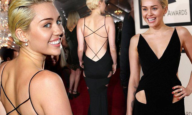 Miley Cyrus stuns in backless black cut-out dress at Grammy Awards