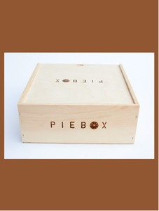 """""""One of our favorite Renegade Craft Fair vendors - seemed like every person we passed was carrying a PIieBox bag."""" PieBox™ is a reusable, handcrafted raw pine box designed to safely transport pie. """"Whether you're driving, biking, busing or even just walking, PieBox will keep your pie safe and intact wherever you go.""""Made in Chicago from chemical-free, raw pine. Measures 11""""x11""""x4"""" - large enough for even a 9"""" deep-dish"""