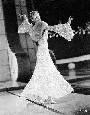 """Ginger Rogers dances to """"Lets Face the Music and Dance"""" in """"Follow the Fleet"""". Ive been lucky enough to actually hold this dress. It weighs about 25 lbs, but it sure doesnt look like it!:"""