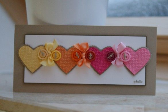 Kraft paper, hearts, buttons AND bows- maybe you can make a banner out of something like this? For Mitzie