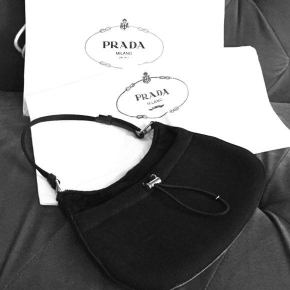 Prada handbag Very rare authentic Prada handbag Black microfiber front, fur back ,gently used, very feminine and classy Prada Bags Mini Bags