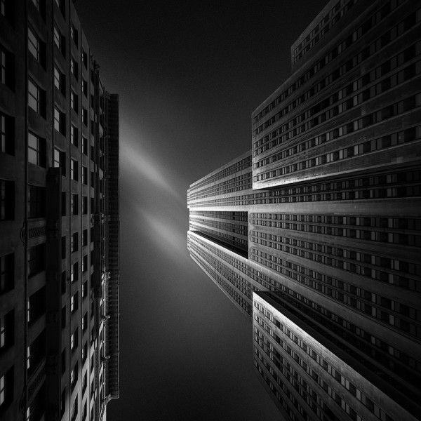 Black and White Empire State Building by Joel Tjintjelaar
