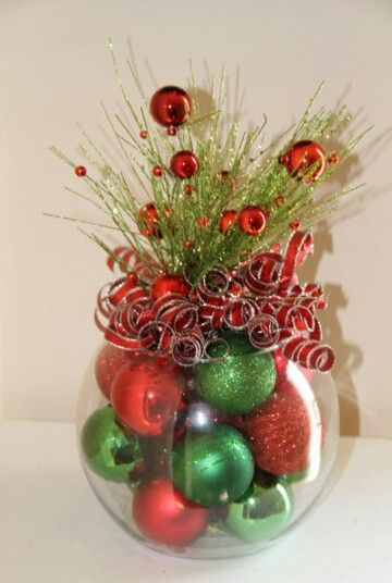 Made with red and green Christmas tree decorations.