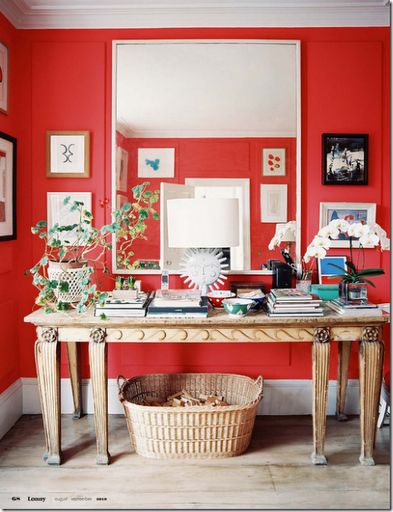 Bright red hall with cream console and mirror
