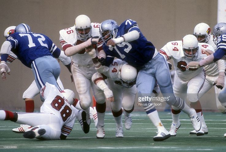 Conrad Dobler #66 of the St. Louis Cardinals in action against Jethro Pugh #75 of the Dallas Cowboys during an NFL football game at Busch Stadium circa 1972 in St. Louis, Missouri. Dobler played for the Cardinals from 1972-77.